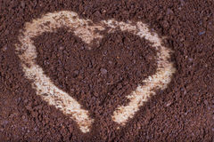 Ground roasted coffee in the form of heart Stock Photos