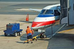 Ground service of airplane. Airplane ground crew at work royalty free stock photos