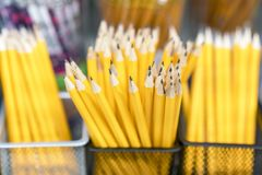 Ground simple yellow pencils on the shelf in the store stock illustration