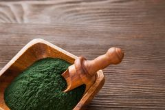 Green smoothie with spirulina on wood background. Ground Spirulina on wood background Stock Photography