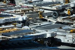 Ground Support Equipment at Atlanta airport. Atlanta, Georgia, USA - October 13, 2016: Ground Support Equipment, dollies for baggage unit load devices at busy Royalty Free Stock Images