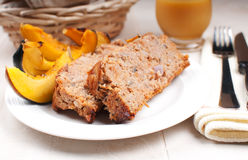 Ground turkey meatloaf and roasted squash Stock Photography