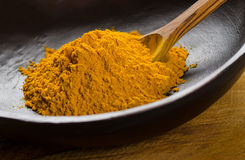 Ground Turmeric stock photos