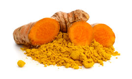 Ground turmeric and rhizomes. Turmeric powder and turmeric isolated on white background Stock Images
