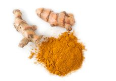 Ground Turmeric And Turmeric Roots. Fresh turmeric roots and ground turmeric on white background close up stock image