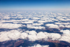On the ground View from behind the clouds. On the ground view of the clouds from the airplane to an altitude of 10,000 metorov above sea level Royalty Free Stock Photos
