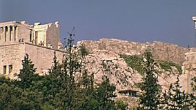 Parthenon temple Athens. Ground view from the road of the Parthenon Ancient Greek temple at the Acropolis of Athens in Greece. Dedicated to Athena goddess stock video