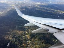 Visible through the window of a flying airplane. royalty free stock photography