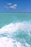 Ground wave  in   and blue   sea drop sunny day Royalty Free Stock Images