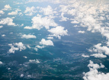 Ground and white fluffy clouds Royalty Free Stock Images