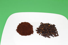 Ground and Whole Cloves royalty free stock photo