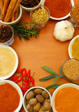 Ground and whole spice and herbs. Border of ground and whole spices and herbs in bowls royalty free stock images