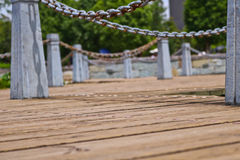 Ground wooden way on a lake side. In Kunming Royalty Free Stock Image