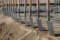 Groundbreaking ceremony. A number of spades in a groundbreaking ceremony of a new building Stock Image