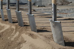 Groundbreaking ceremony. A number of spades in a groundbreaking ceremony of a new building Stock Photos