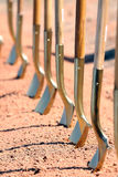 Groundbreaking Ceremony Shovels. A detail shot of the ceremonial shovels used during groundbreaking ceremonies and grand opening events to signal the official Royalty Free Stock Photography