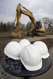 Groundbreaking Ceremony. Worker helmets and goggles stand before starting groundbreaking ceremony Royalty Free Stock Image