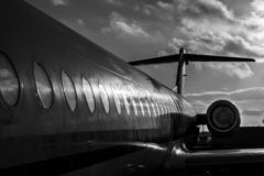 Grounded airplane in black and white royalty free stock image
