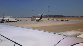 Grounded airplanes tarmac view at Athens airport. Day view of Olympic Air parked aircrafts on Athens International Airport Eleftherios Venizelos apron runway stock footage