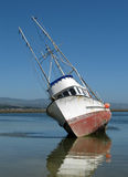 Grounded Boat in Harbor Royalty Free Stock Images