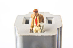 Grounded Businessman. Miniature businessman standing in the grounded part of an outlet Royalty Free Stock Image