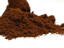 Grounded coffee. Pile of grounded coffee on a white background stock image