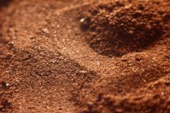 Grounded coffee close-up view. Macro view of grounded coffee powder Stock Image