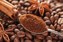 Grounded coffee in silver spoon with cinnamon and star anise Stock Photo