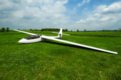 Grounded Glider. A glider preparing for towing with unidentified pilot inside Royalty Free Stock Images