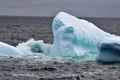 Grounded iceberg calving Stock Image