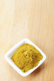Grounded khmeli suneli spice mixture on wood Stock Images