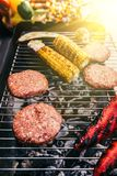 Grounded meat and corn cooked outdoors on grill royalty free stock images
