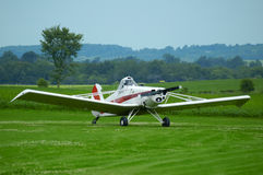 Grounded Plane. A piper pawnee positioning for take off with unidentifiable pilot within Stock Photos