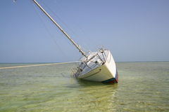 Grounded sailboat Stock Image