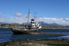 Grounded tug boat abandoned in Ushuaia Harbor. Saint Christoper or HMS Justice grounded and abandoned in Ushuaia Harbor, Argentina Royalty Free Stock Photos
