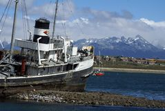 Grounded tug boat abandoned in Ushuaia Harbor. Saint Christoper or HMS Justice grounded and abandoned in Ushuaia Harbor, Argentina Royalty Free Stock Images