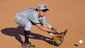 Grounder maggiore di serie di mondo di baseball della lega Fotografia Stock