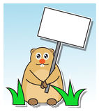 Groundhog Day. Marmot in the grass holding a sign in his paws Stock Photography