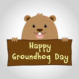 Groundhog Holding a Wooden Sign Royalty Free Stock Photo