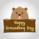 Groundhog som rymmer ett trätecken royaltyfri illustrationer