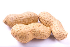 Groundnut seeds in shells on white Royalty Free Stock Photos