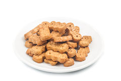 Groundnut shaped biscuit on plate isolated in white Stock Photo