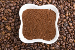 Grounds coffee on coffee beans Stock Images