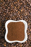 Grounds coffee on coffee beans Royalty Free Stock Photos