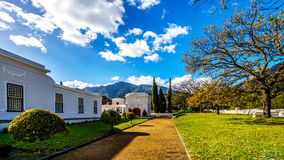 The grounds surrounding the historic Huguenot Museum building in the town of Franschhoek Stock Photos