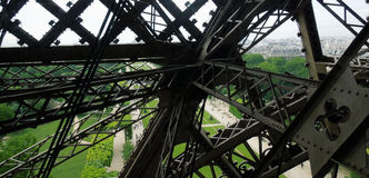 Eiffel Tower view through iron beams Royalty Free Stock Image