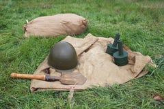Groundsheet, grenades, helmet, shovel Stock Images