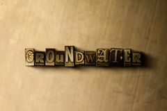 GROUNDWATER - close-up of grungy vintage typeset word on metal backdrop Stock Image