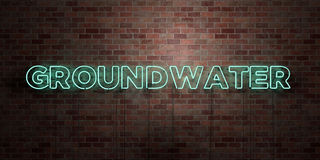 GROUNDWATER - fluorescent Neon tube Sign on brickwork - Front view - 3D rendered royalty free stock picture Royalty Free Stock Photo