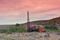 Groundwater hole drilling machine in Arizona. Groundwater hole drilling machine installed on the old truck. in Arizona stock image
